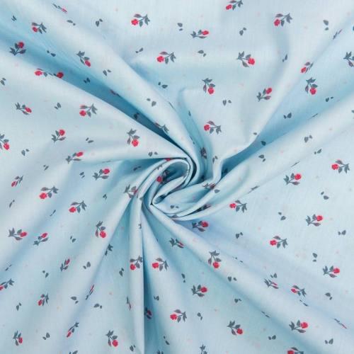 Popeline de coton bleue motif petite rose