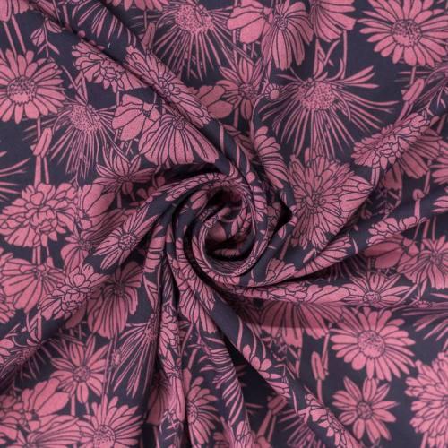 Mousseline crêpe bleu marine motif fleur rose foncé