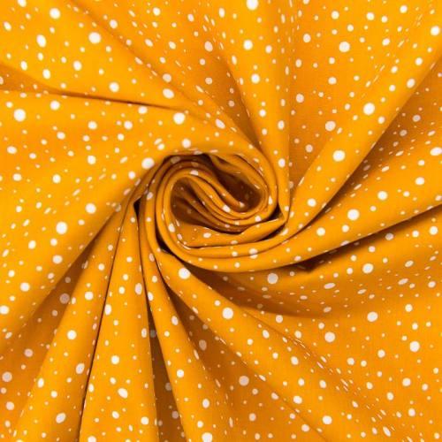 Popeline de coton ocre motif rond blanc