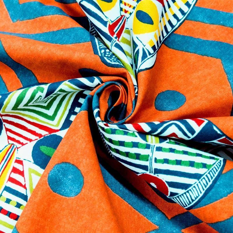 Coton bachette orange motif masque africain