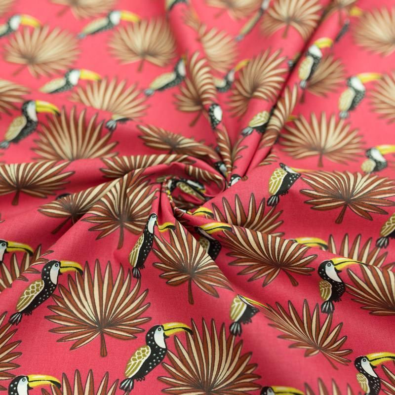 Coton framboise motif toucan et feuille de palmier