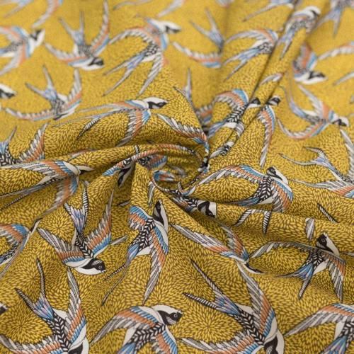 Coton jaune motif hirondelle