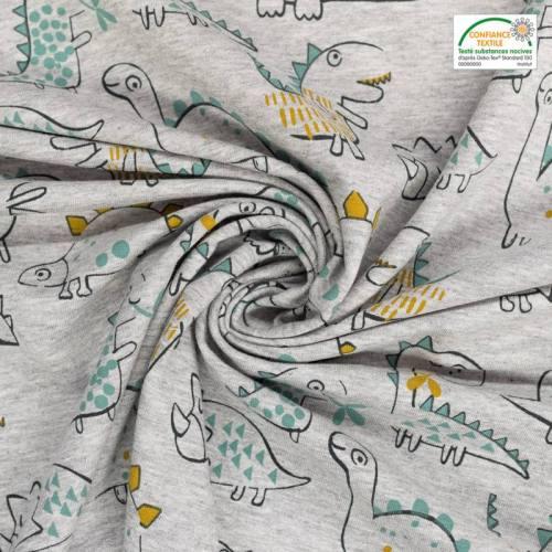 Tissu molleton french terry gris motif dinosaure vert et ocre