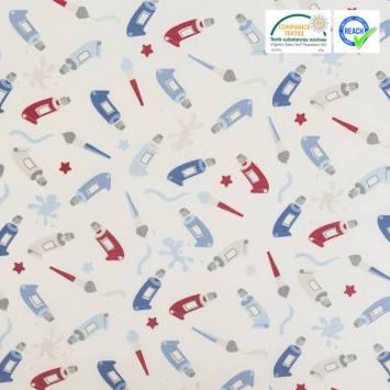 Coton enduit écru motif peinture bleue et rouge
