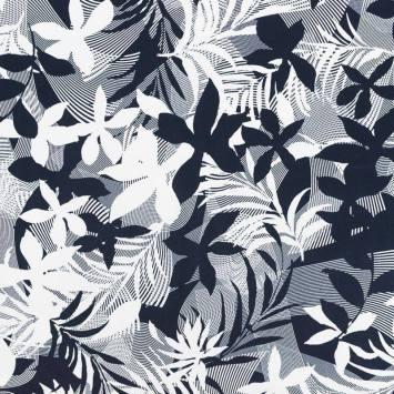 Satin de coton extensible bleu nuit motif feuilles et courbes blanches