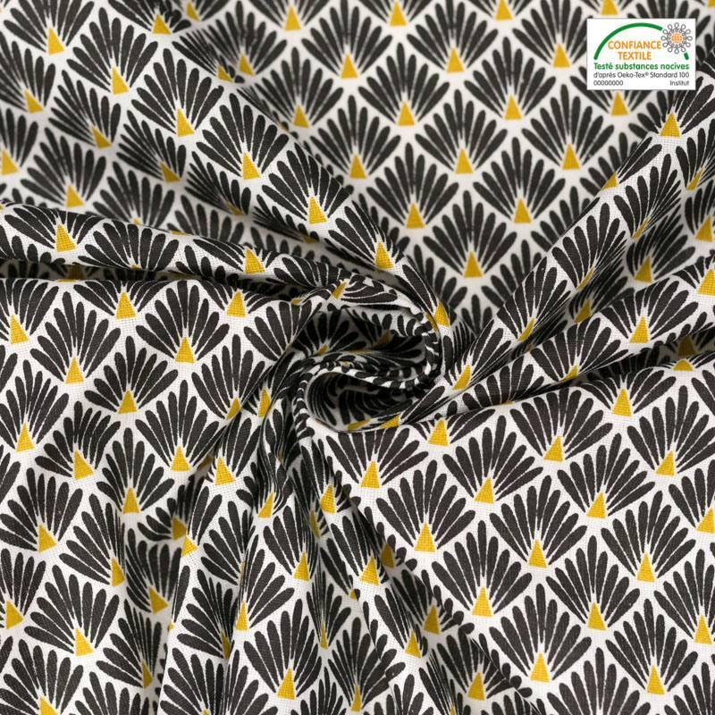 Coton imprimé écailles noires et ocre