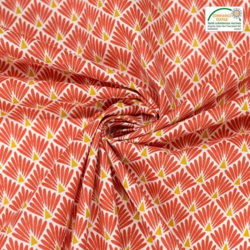 Coton imprimé écailles rouge brique et ocres