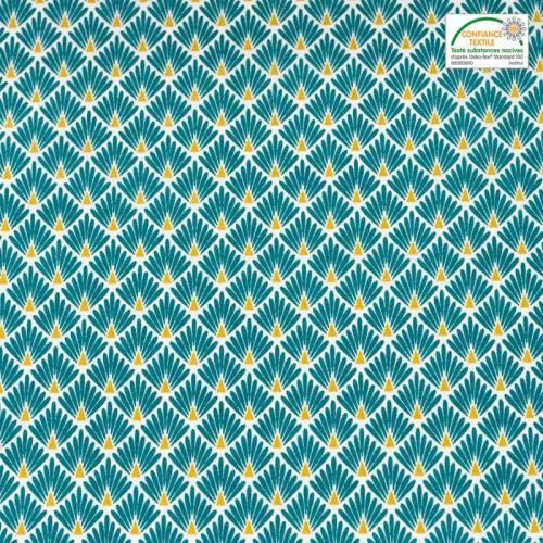 Coton imprimé écailles bleu canard et ocre