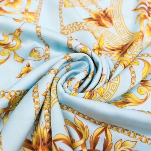 Satin bleu pastel motif foulard et arabesques or