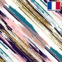 Lycra écru motif traits de peinture violets vert canard et paillettes