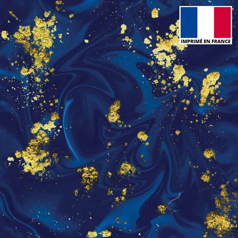 Lycra imprimé magma bleu et feuilles d'or