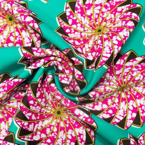 Lycra vert imprimé wax hélice rose