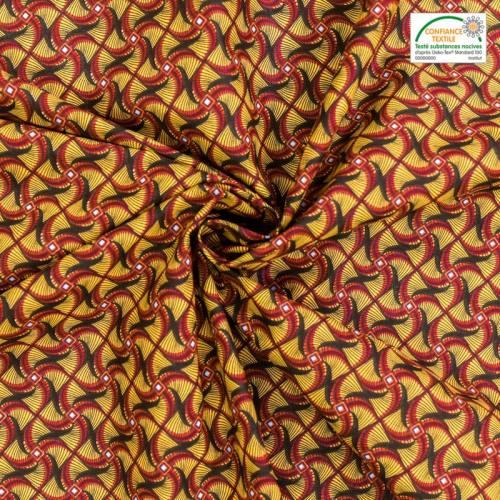 Coton jaune imprimé wax hélice rouge