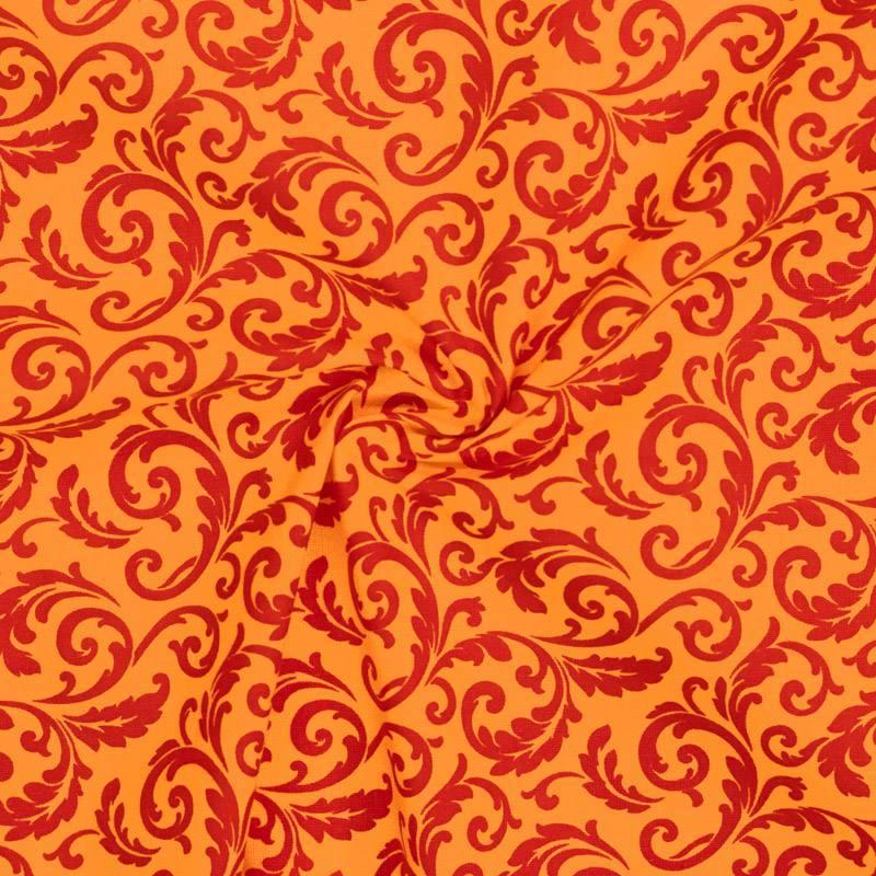Coton orange imprimé arabesques végétales rouges