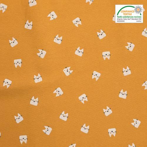 Flanelle de coton ocre imprimée chats blancs