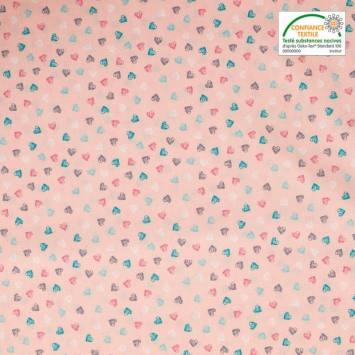 Popeline de coton rose imprimée coeurs multicolores