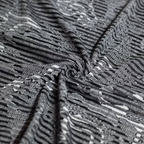 Jersey jacquard gris motif fleur abstraite