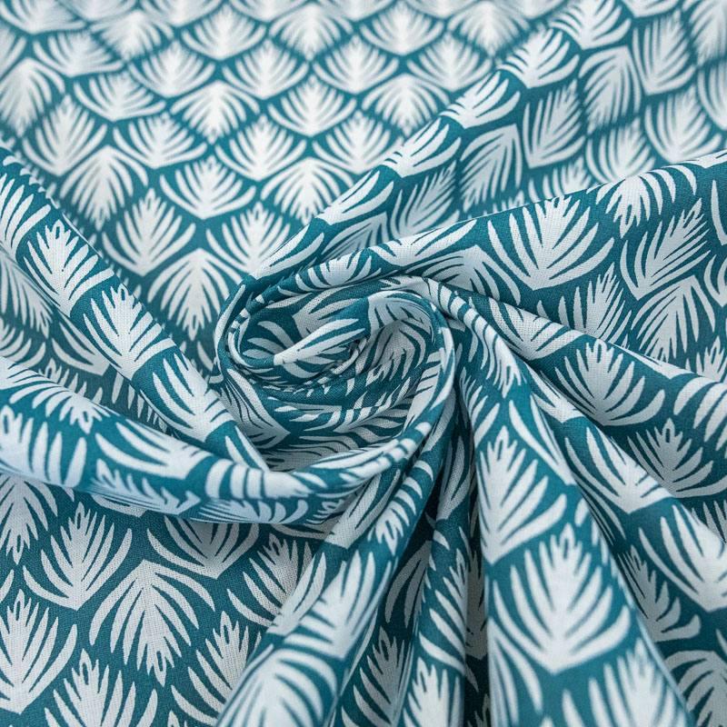 Coton bleu motif aria blanc