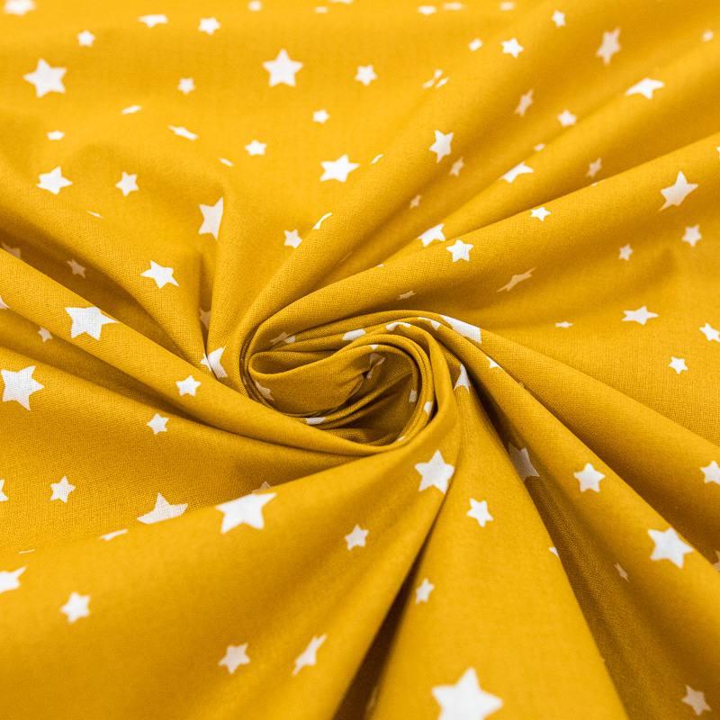 Coton ocre motif étoiles blanches