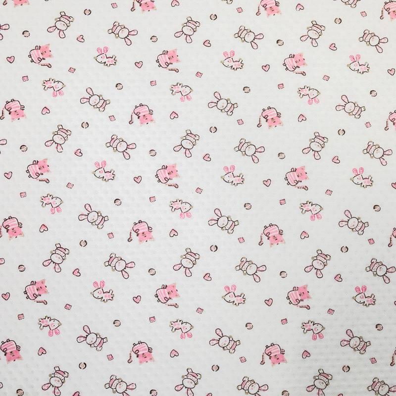 Jersey molleton ajouré écru motif lapins roses