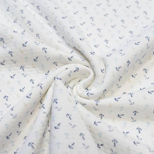 Jersey molleton ajouré écru motif encres bleues