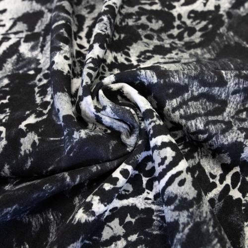 Tissu scuba crêpe noir imprimé jungle gris