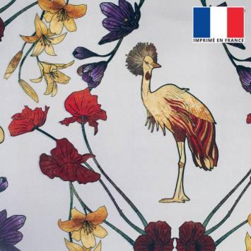 Velours ras grège imprimé grue royale et fleurs ocre, rouges et violettes
