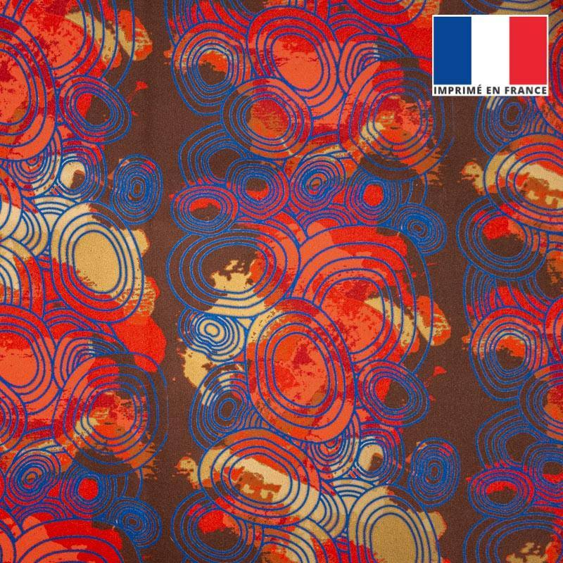 Velours ras marron motif rond bleu sur fond rouge