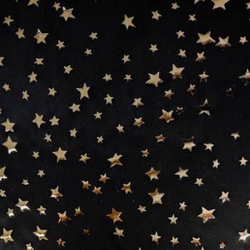 Tissu satiné noir motif étoiles dorées