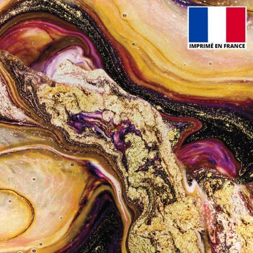 Lycra imprimé magma noir et jaune poudre d'or