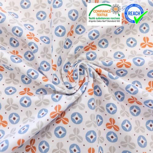 Coton blanc motif rexpoi bleu et brique