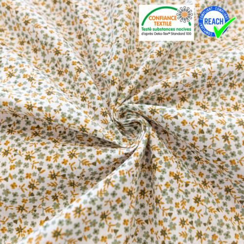 Coton blanc motif petite fleur et feuille curry et vert sauge pio