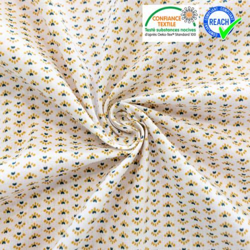 Coton blanc motif petite fleur ocre et bleue capra