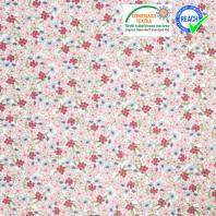 Coton fleurs lilas vert et rose