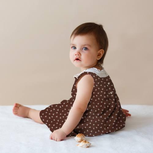Coton marron motif fleur blanche