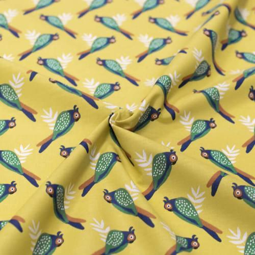 Coton jaune vert motif oiseau tropical