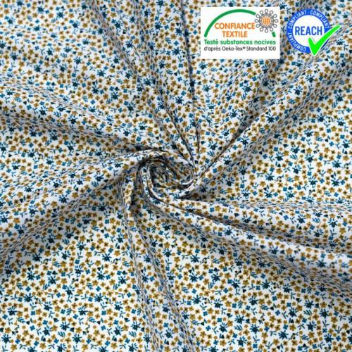 Coton blanc motif petites fleurs bleues et ocre pamea