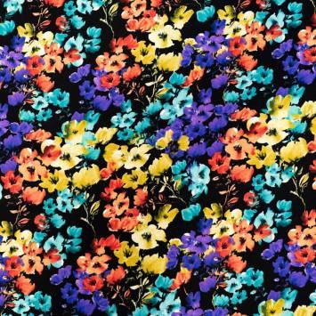Tissu viscose noir motif petite fleur jaune orange et violette