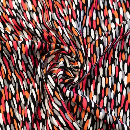 Tissu viscose noir motif rose orange chally