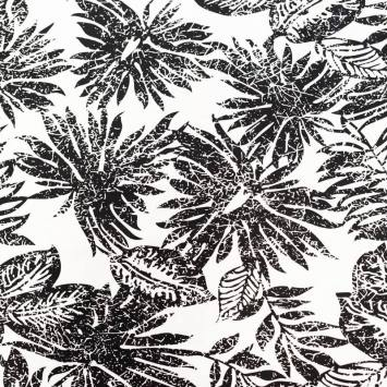 Satin de coton extensible écru motif grandes feuilles noires