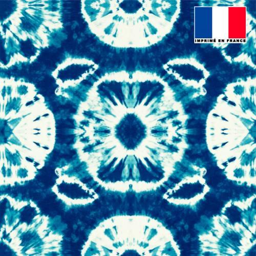 Mousseline crêpe bleu marine motif tie and dye rond vert d'eau