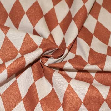 Toile polycoton beige motif losange orange pailleté