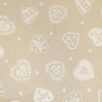 Toile polycoton beige motif coeur blanc