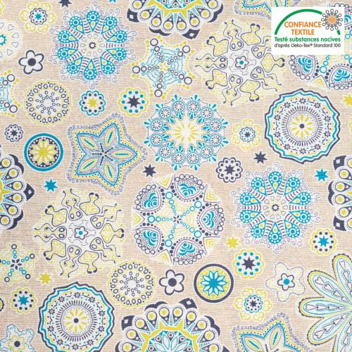 Coton bio enduit beige motif fleur verte et bleue