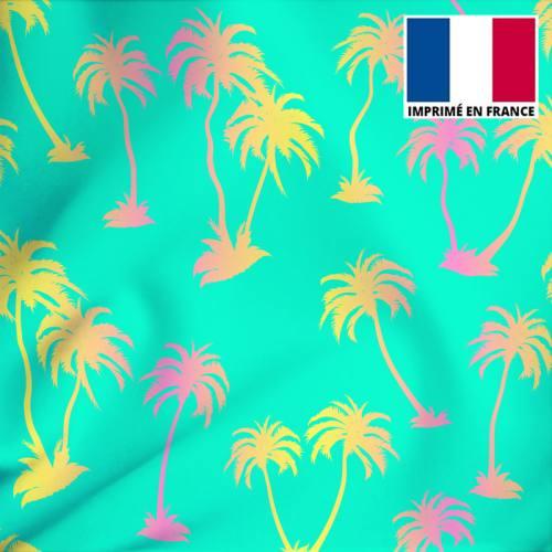 Tissu microfibre vert d'eau imprimé palmier jaune et rose
