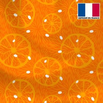 Lycra orange motif orange et pois blanc