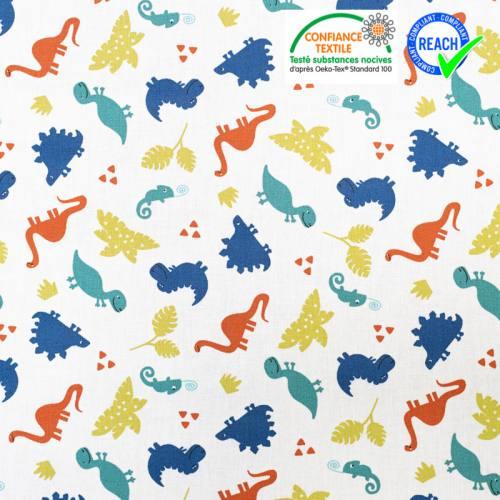 Coton blanc motif dinosaure bleu et vert terry