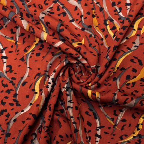 Tissu viscose rouge brique motif léopard et tigré