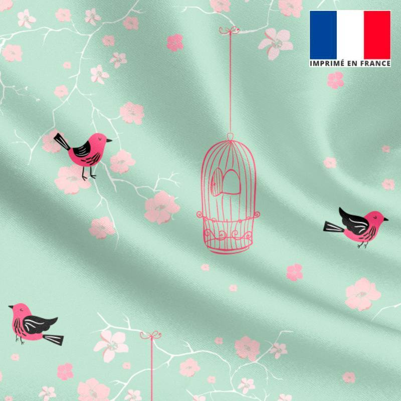 Satin vert d'eau motif fleur de cerisier rose et cage à oiseaux