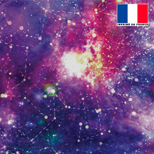 Mousseline crêpe imprimée galaxie constellations bleu et rose
